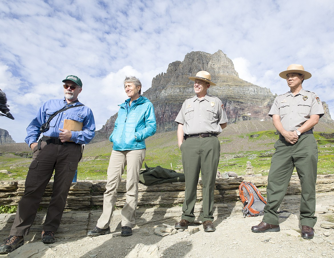 In this 2016 photo, U.S. Geological Survey Scientist Dan Fagre, left, stands with former Secretary of Interior Sally Jewell, Glacier Deputy Superintendent Eric Smith and Glacier Superintendent Jeff Mow on the Hidden Lake Trail at Logan Pass in Glacier National Park. (Chris Peterson/Hungry Horse News FILE)