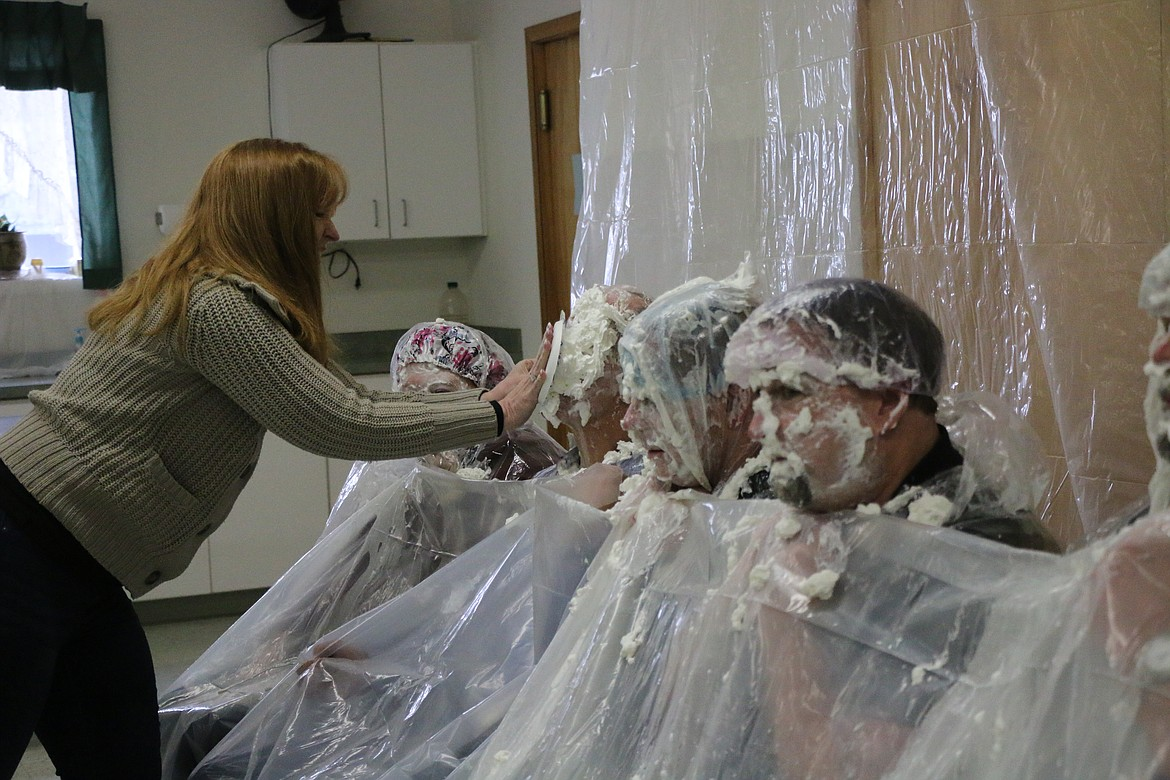 (Daily Bee file photo/CAROLINE LOBSINGER)   Bryan Hult from Bonner County Veterans Services takes a pie to the face, as did a number of other volunteers, during last year's fundraiser, which garnered $1,005 for Sandpoint Area Seniors, Inc. programs.
