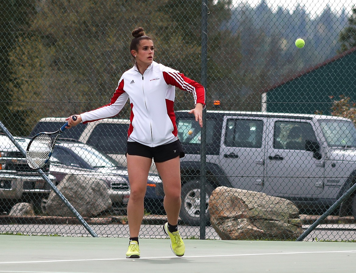 (Photo by KYLE CAJERO)   Sandpoint's Jenny Slaveck prepares to smash a forehand during a match against Post Falls on May 1, 2019. Slaveck is a finalist for the girls tennis award.