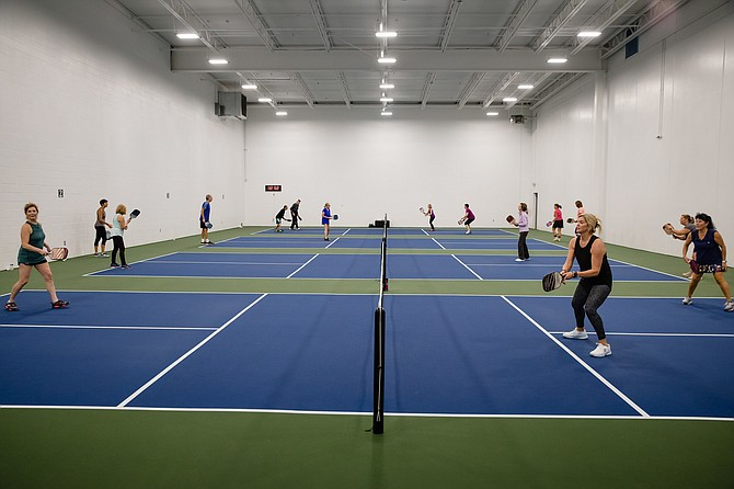 Photo by JEROME POLLOS PHOTOGRAPHY   The four pickle ball courts are filled with players at the Hayden Peak Fitness location.
