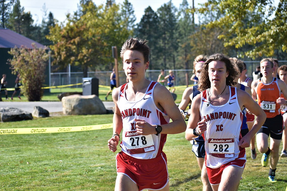 (Photo by DYLAN GREENE)   Juniors Nikolai Braedt (front) leads the pack during the William Johnson Sandpoint Invitational on Oct. 12 at Travers Park.