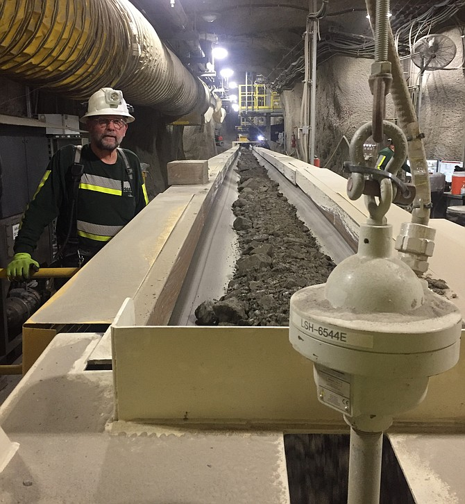 Clayr Alexander watches ore travel the belt to the #4 shaft, where it will be transfered to the surface and processed.