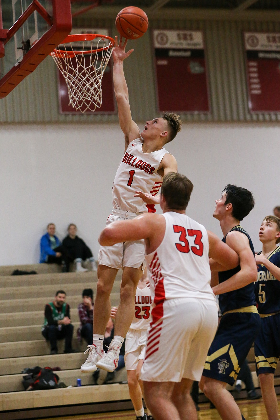 (Photo courtesy of JASON DUCHOW PHOTOGRAPHY)   Senior Ryan Roos converts a layup during a game this season at Les Rogers Court.