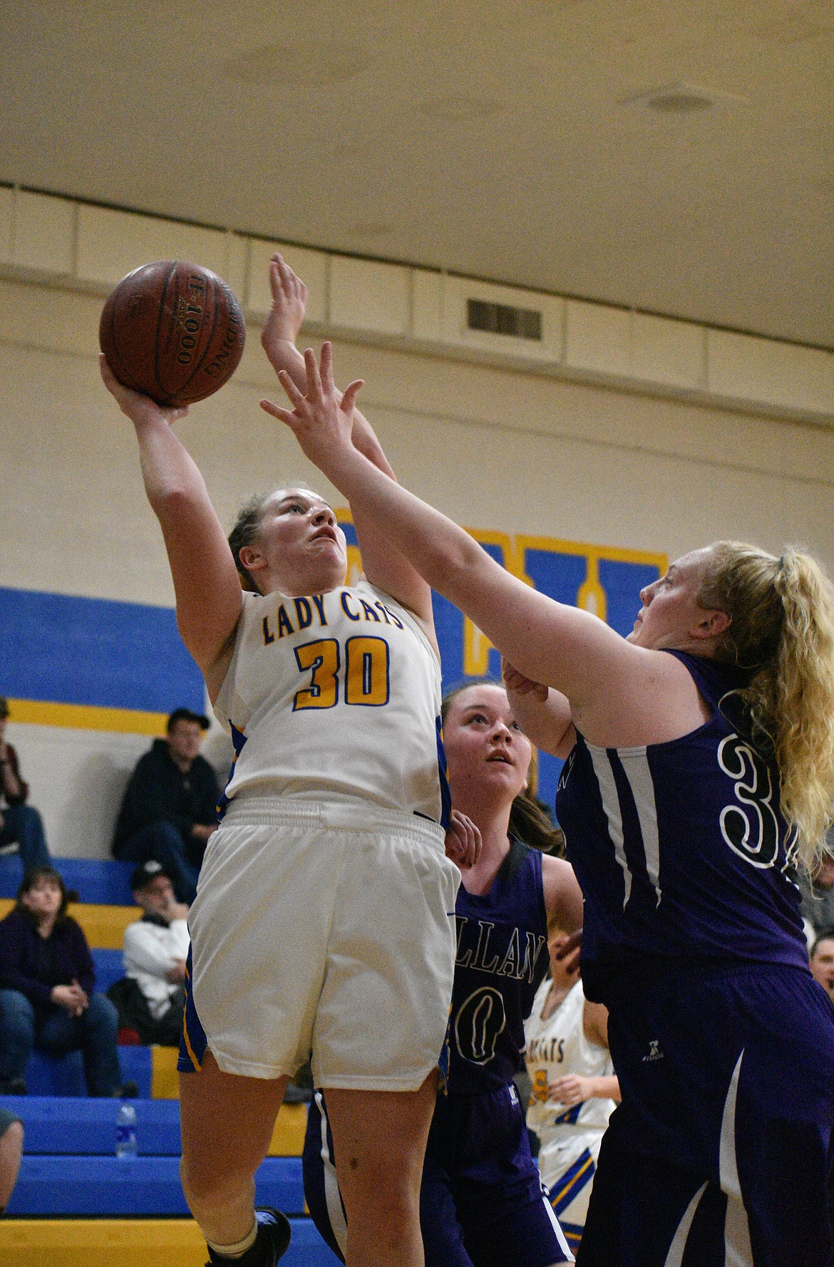 (Photo by DYLAN GREENE)   Senior Ellie Kiebert puts up a shot over the outstretched arm of a Mullan defender during a game this year. Kiebert is a finalist for the 3A-1A girls basketball award.