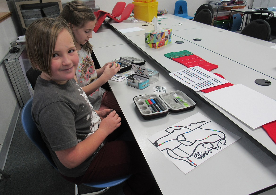 (Courtesy photo)   An Idaho Hill Elementary fourth grader smiles during a session with Ozobot bits coding for National Hour of Code recently. The activity was just one of many the school did as part of its STEaM — Science Math Engineering Arts and Math — program.