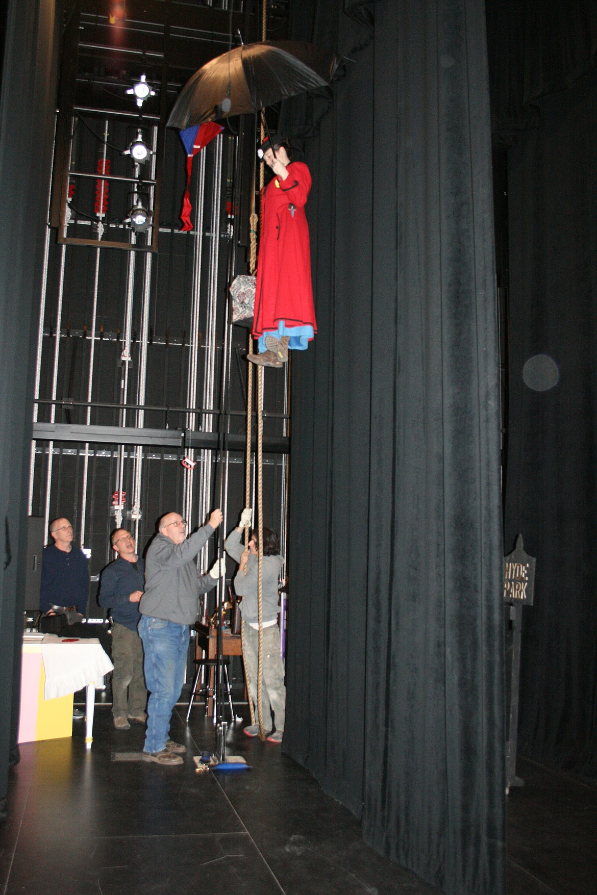 Quincy Valley Allied Arts stage crew members hoist Mary Poppins (Stephanie Moore) into the air. The company's production opens Feb. 20.