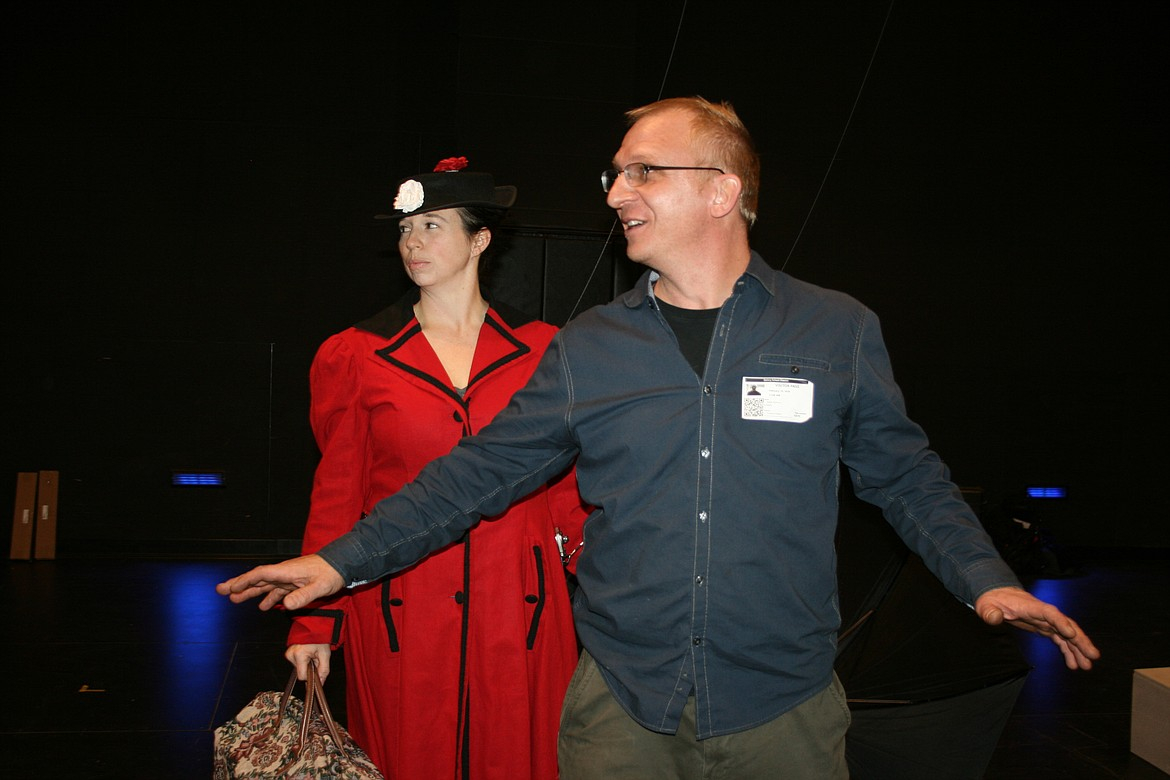 Flying director Mark Kostuch (foreground) gives instructions to Stephanie Moore, playing Mary Poppins. The Quincy Valley Allied Arts production opens Feb. 20.