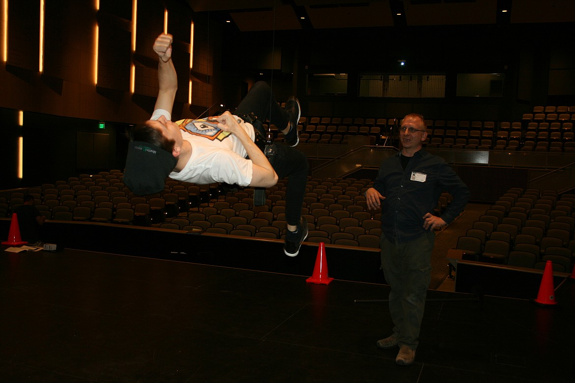 "Bert (Taylor Street. left) climbs an invisible tube into the air in the Quincy Valley Allied Arts production of ""Mary Poppins,"" opening Feb. 20. Flying director Mark Kostuch supervises."