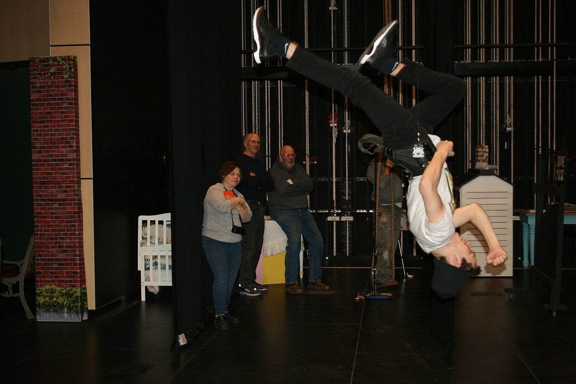 "Taylor Street (upside down) practices flips for the Quincy Valley Allied Arts production of ""Mary Poppins."" The production opens Feb. 20."