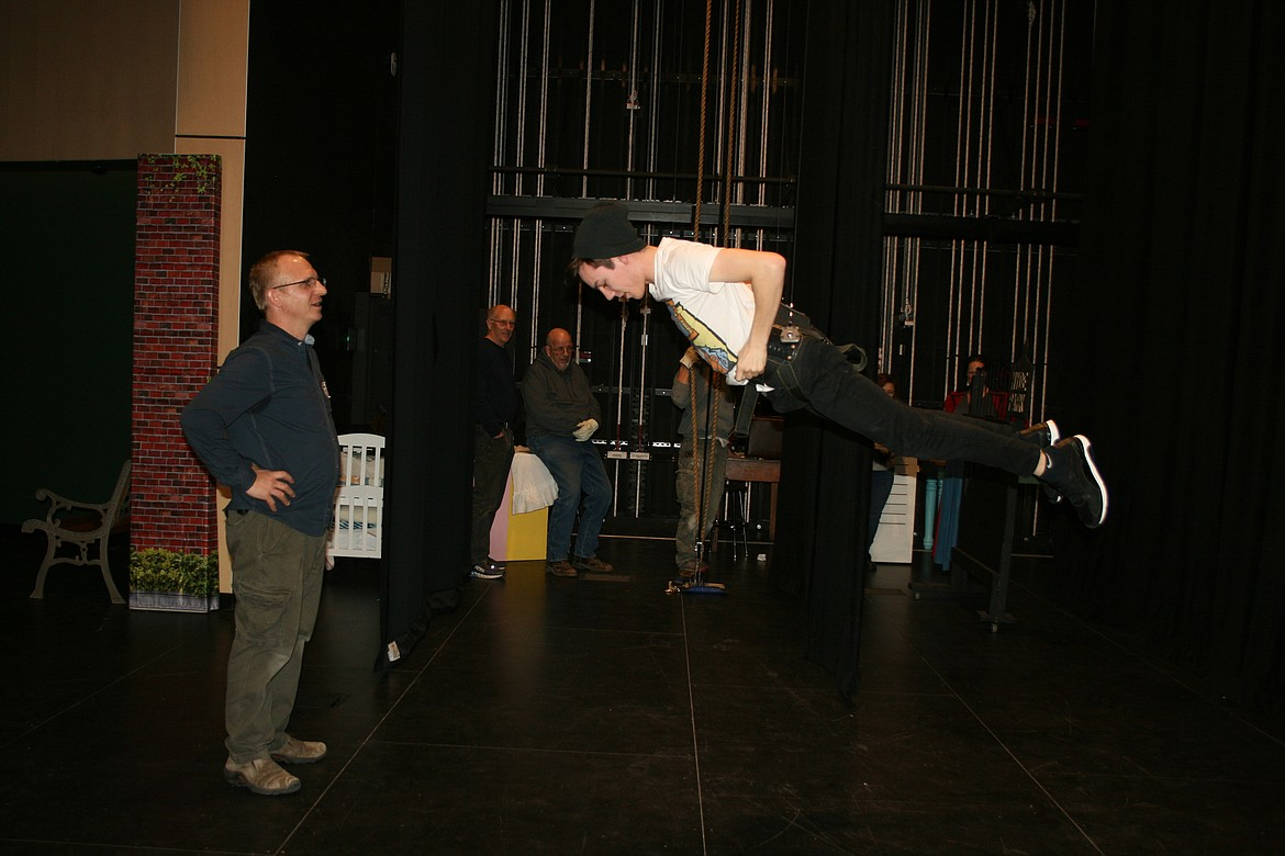 """Taylor Street (right) gets a lesson in flight from flying director Mark Kostuch. Street plays Bert in the Quincy Valley Arts production of """"Mary Poppins,"""" opening Feb. 20."""