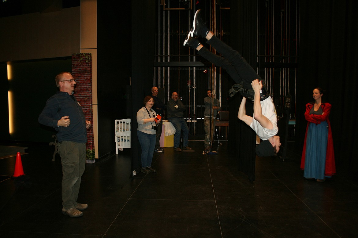 """Taylor Street (right) gets a lesson in aerial acrobatics from flying director Mark Kostuch. The curtain goes up on the Quincy Valley Allied Arts production of """"Mary Poppins"""" Feb. 20."""
