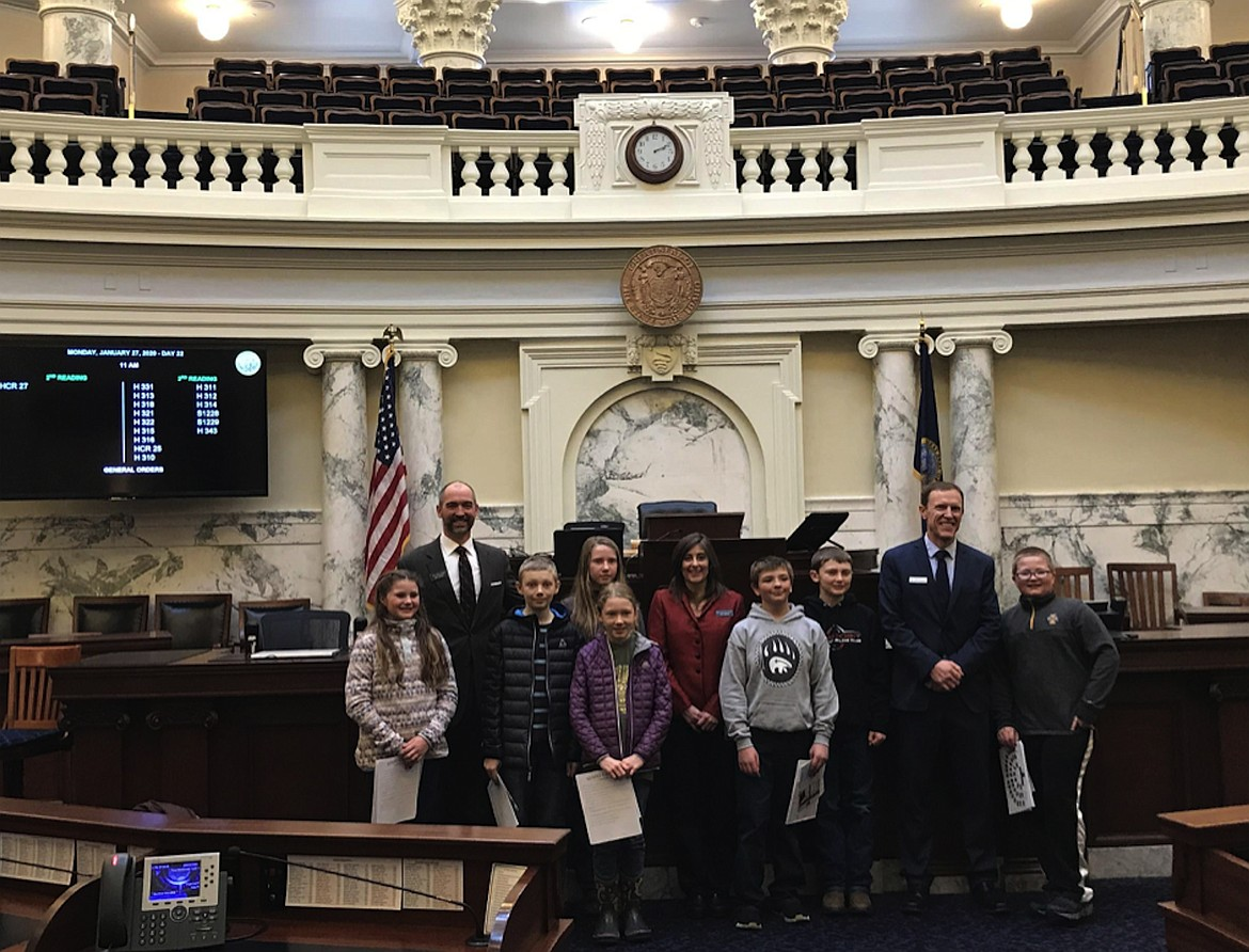 Bonner County Future City students pose with District 1 legislators during a tour of the Capitol building.