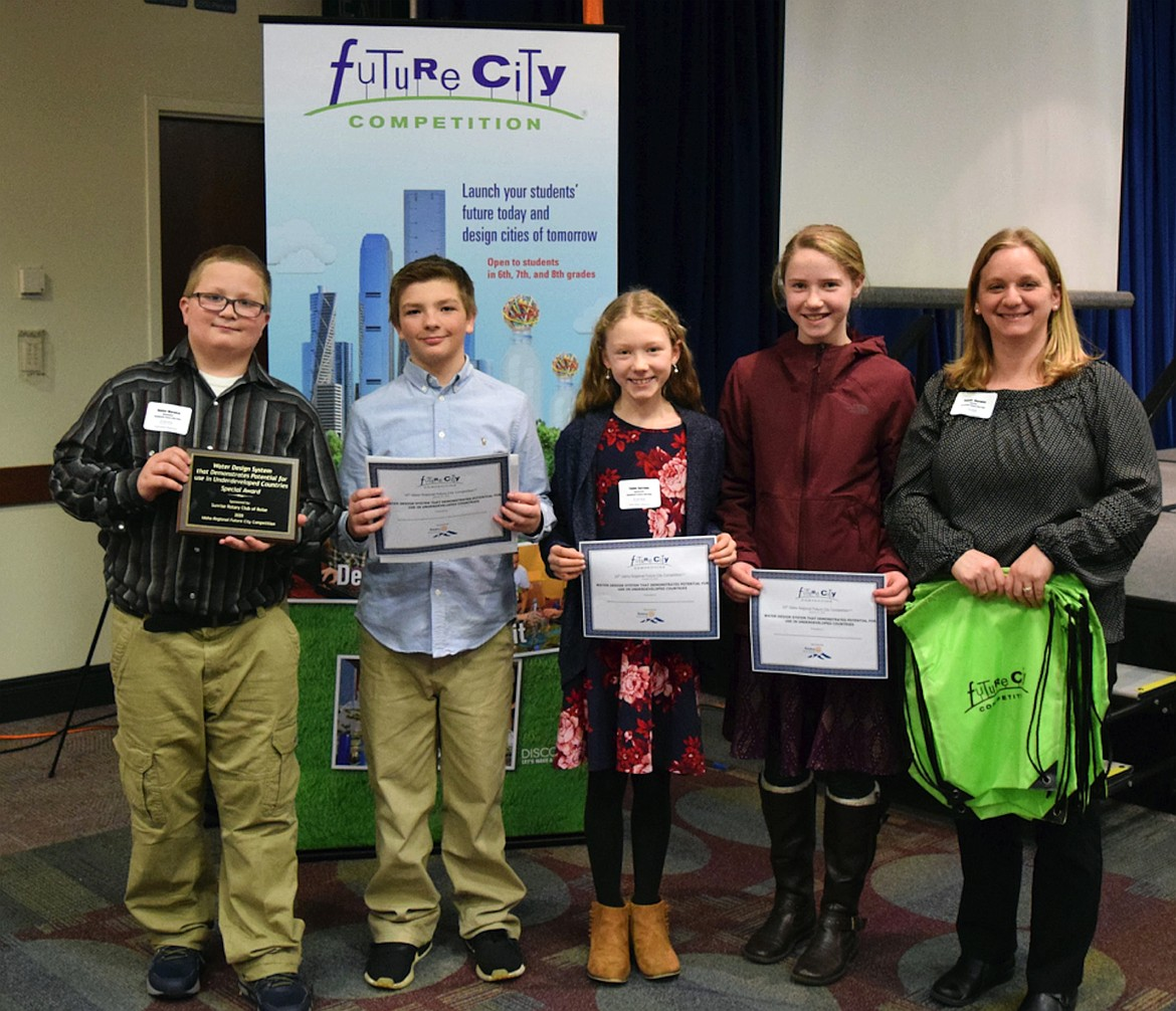 Team Aqualantis made up of Hunter Warwick, Taylor Ailport, Dakota Rief, and Taylor Burrows won the award for water design system that demonstrates potential for use in underdeveloped countries. They are pictured with Northside teacher Jeanne Warwick.