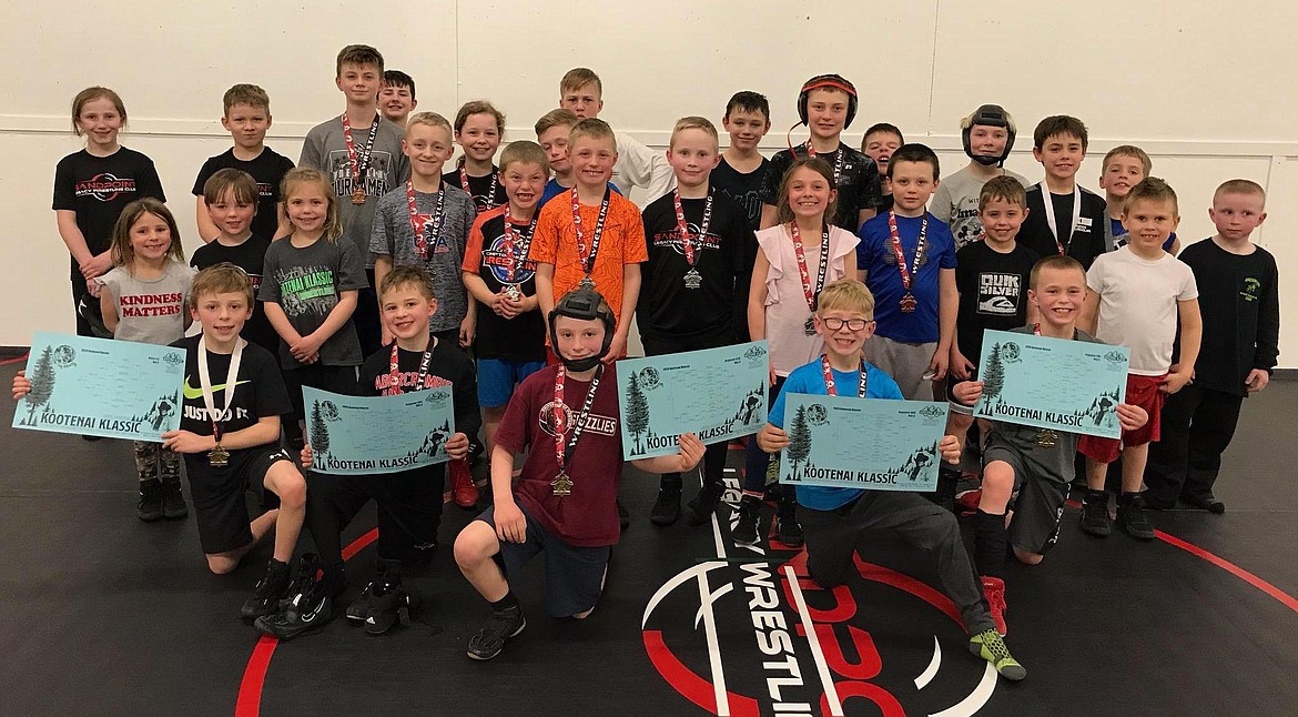 The Sandpoint Legacy team shows off their hardware from the Kootenai Klassic Tournament. Fifteen of the 21 wrestlers earned a medal in the last tournament of the team's shortened season.