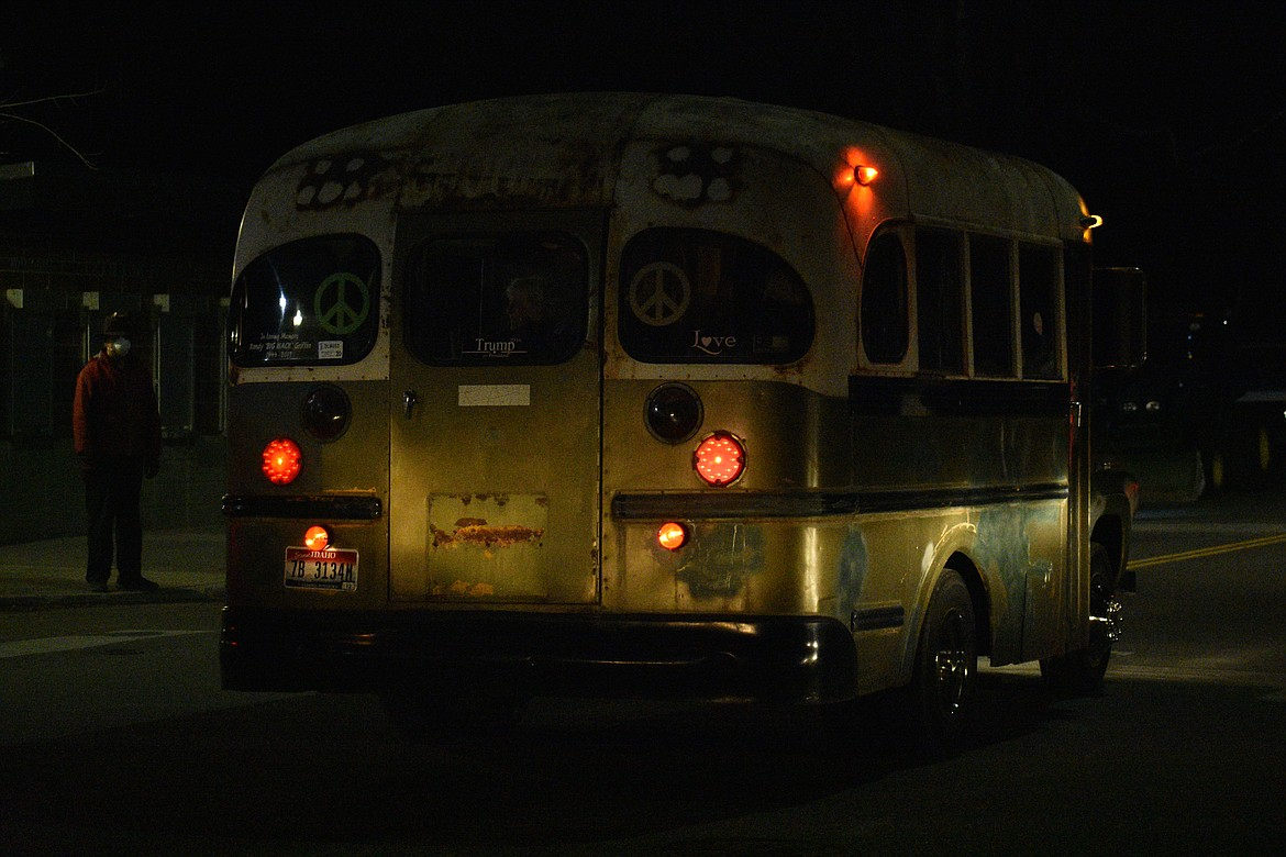 "(Photo by DYLAN GREENE)   A retro bus cruises down Ontario Street during the ""Be the Light"" celebration Friday night at War Memorial Field."