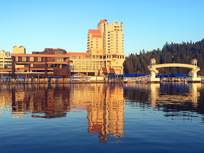 A reflection of The Coeur d'Alene Resort adds color to Lake Coeur d'Alene.