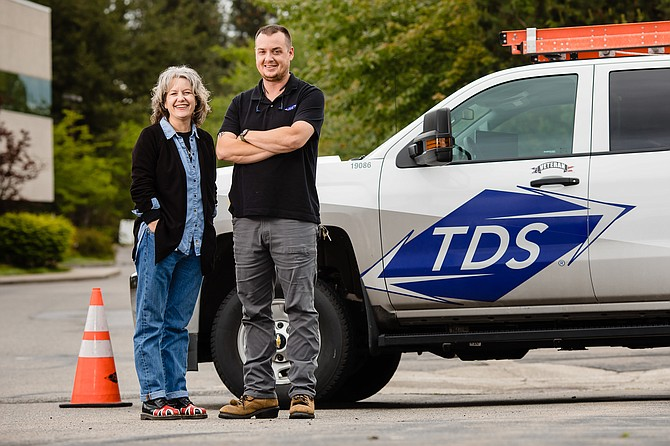Anita Parisot, left, the field marketing manager for TDS in Coeur d'Alene, and Josh Ferguson, a field service supervisor for TDS, are both longtime residents of the area who were hired by the telecommunications company.