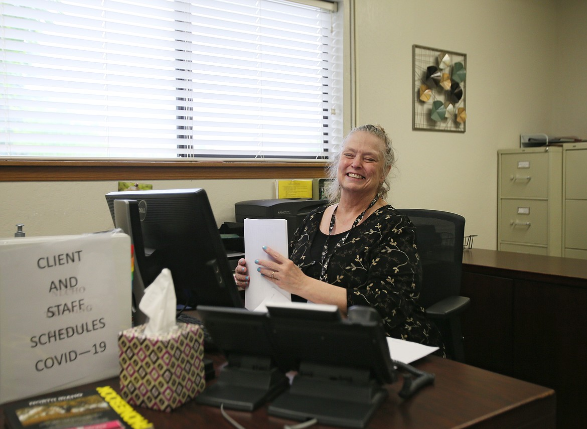 Linda Johnson, who works in billing at Tesh in Coeur d'Alene, is cheery and happy to return to the office Monday morning after COVID-19 closures.