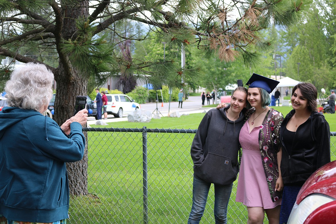 (Photo by CAROLINE LOBSINGER)   A Forrest M. Bird Charter School graduate gets her photo taken with family and friends at the school's graduation ceremony on Saturday.