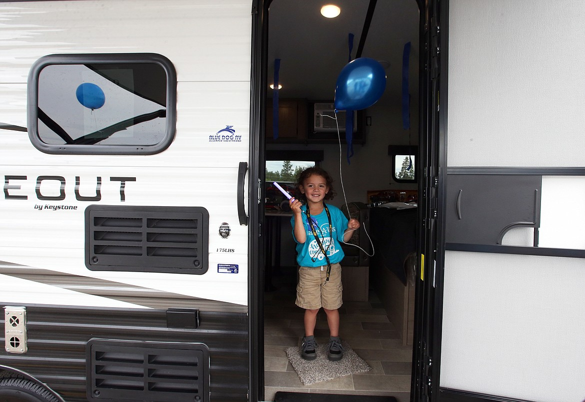BILL BULEY/Press   Christopher Blood looks out the door of his family's new RV courtesy of the Make-A-Wish Foundation on Thursday at Blue Dog RV in Post Falls.