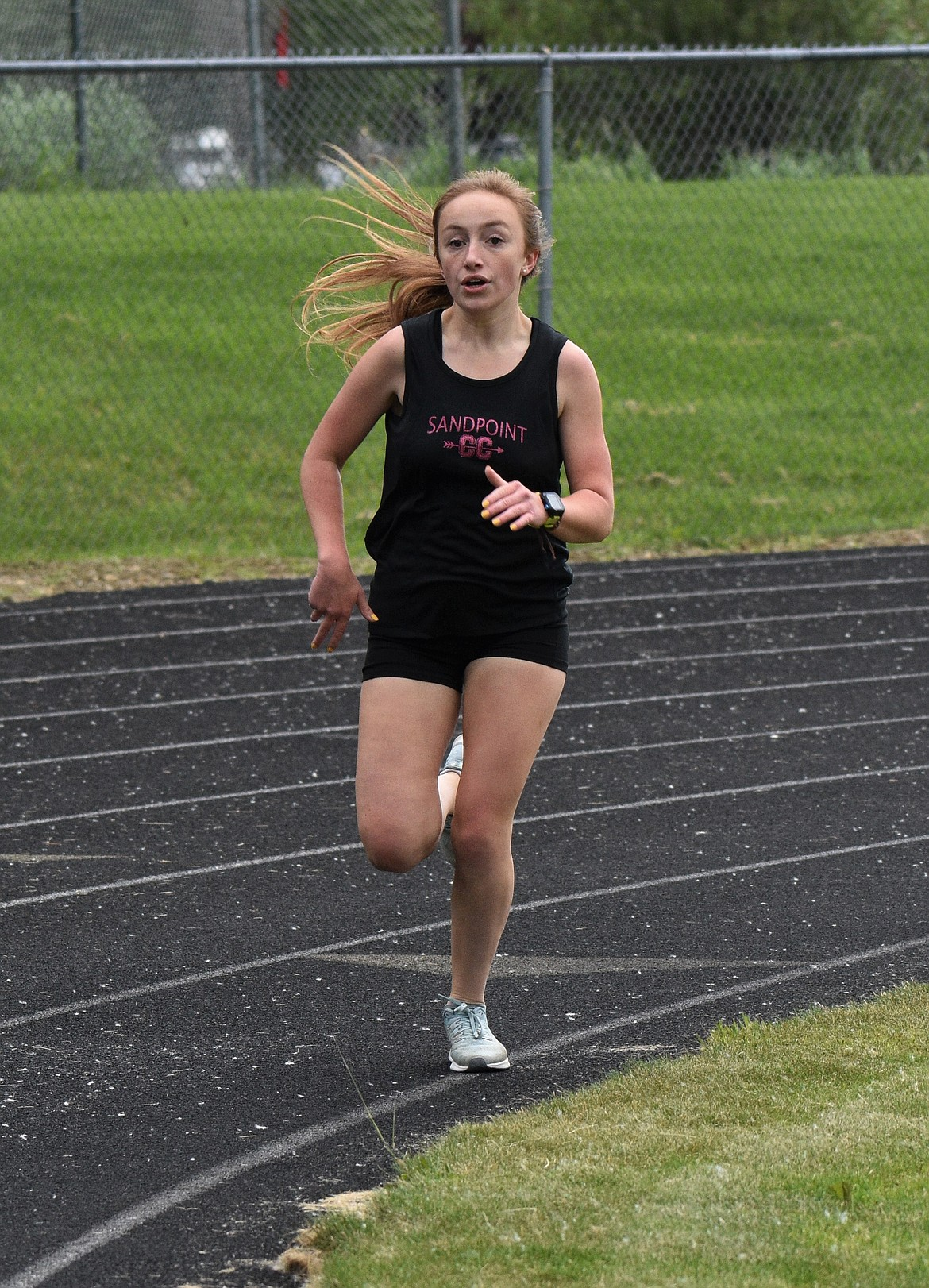 (Photo by DYLAN GREENE)   Junior Camille Neuder rounds the track in the girls 800.