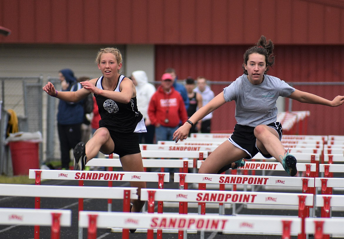 (Photo by DYLAN GREENE)   Paige Davidson (left) and Sara Hathaway compete in the girls 100 meter hurdles Saturday.
