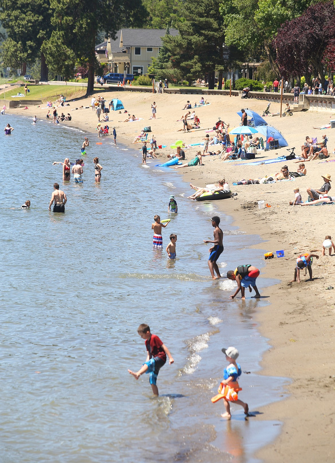 BILL BULEY/Press   City Beach is crowded on a sunny Monday morning.