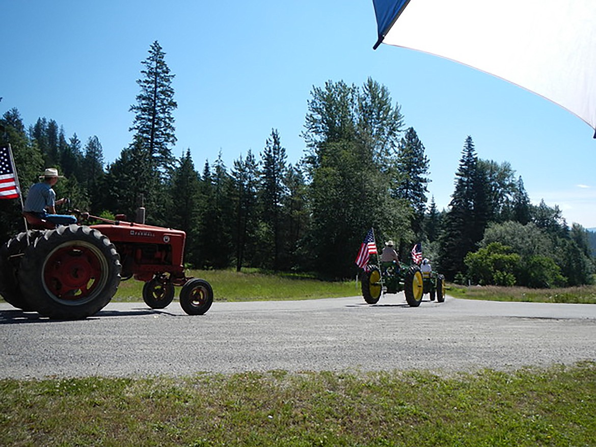 (Photo courtesy JERRY LUTHER)   A series of tractors make their way down the parade route during the annual Fourth of July parade in the Garfield Bay area in Sagle.
