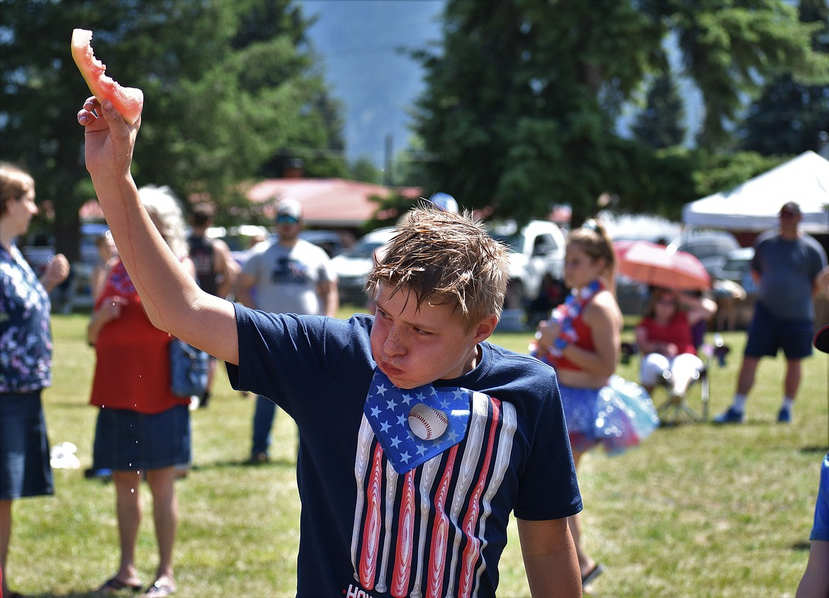 (Photo by DYLAN GREENE)   A young boy holds up his watermelon rind to claim victory.