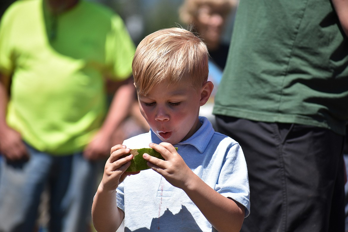 (Photo by DYLAN GREENE)   A young boy set his eyes on his target — a slice of watermelon.