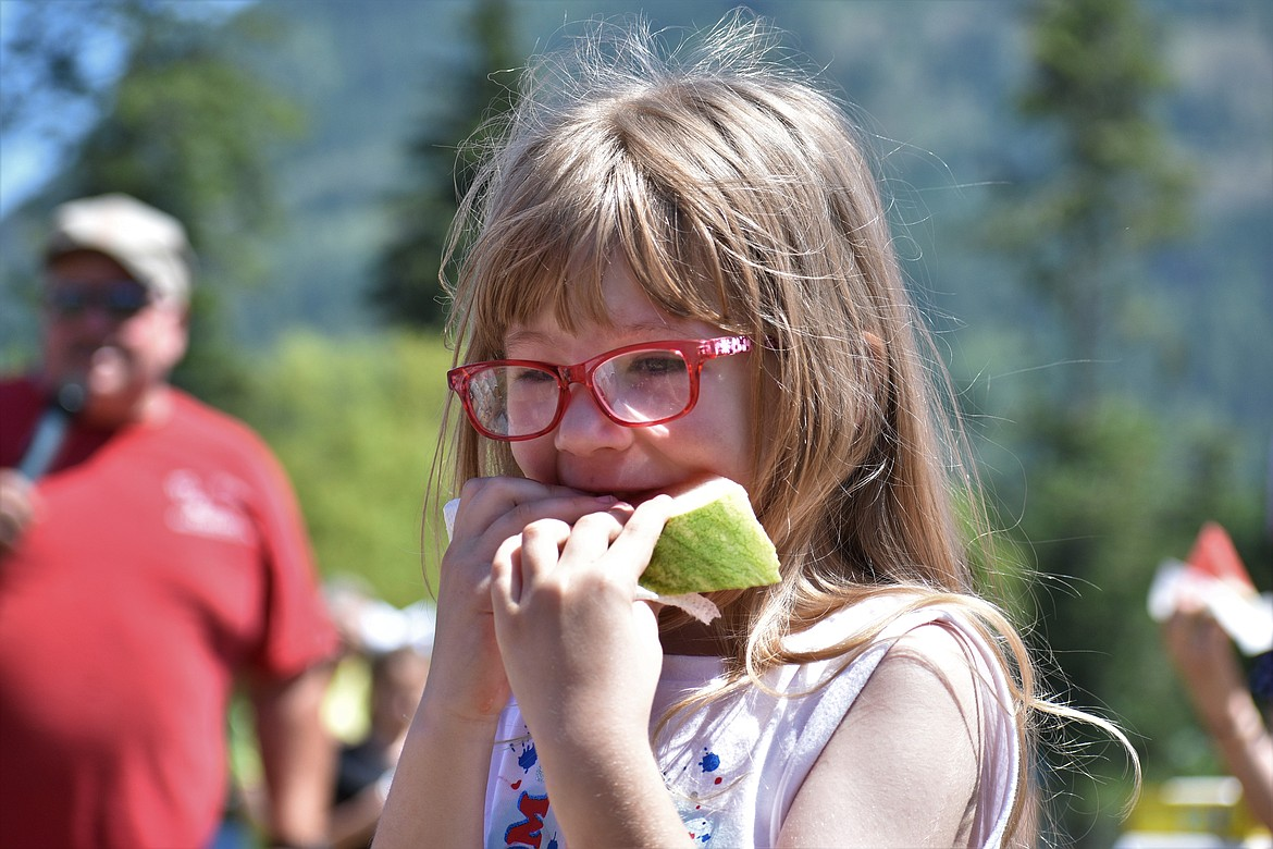 (Photo by DYLAN GREENE)   A young girl chips away at her watermelon.