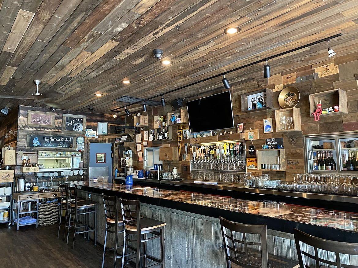 Midtown Bluebird's old-fashioned theme is carried out through the wood and steel features, noticeable in the bar area.
