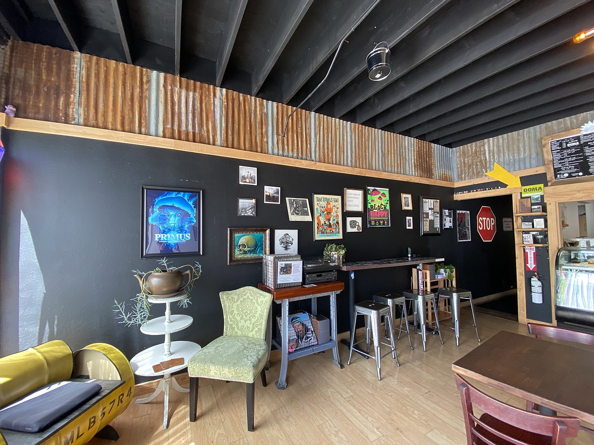 The inside of White Pine at 814, features classic records, concert posters and trendy decor.