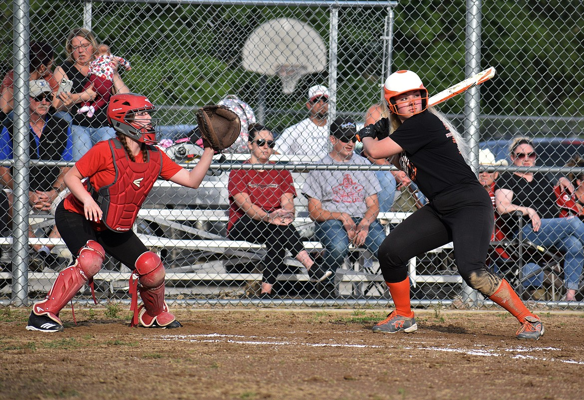 Adrie Minish, 2020 Priest River grad, stares down a pitch during a softball scrimmage at Sandpoint on July 8. The Spartans also played a scrimmage at the Bulldogs last Wednesday, losing 19-12.