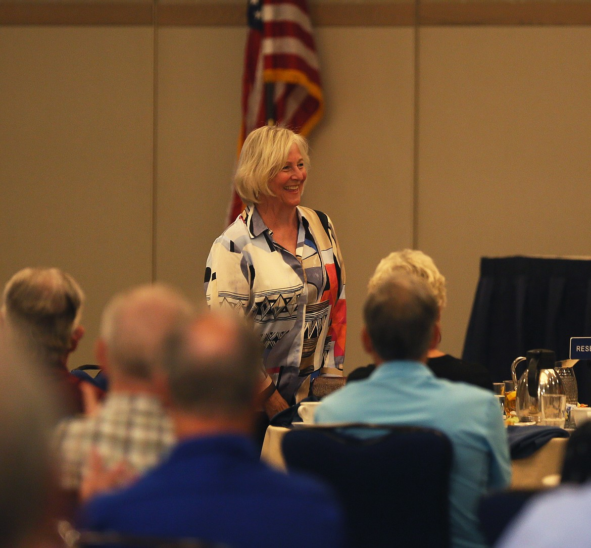 Vicki Risch, a former first lady of Idaho and Sen. Jim Risch's wife of 52 years, says hello to Rotary members during a meeting in The Coeur d'Alene Resort on Friday. (DEVIN WEEKS/Press)