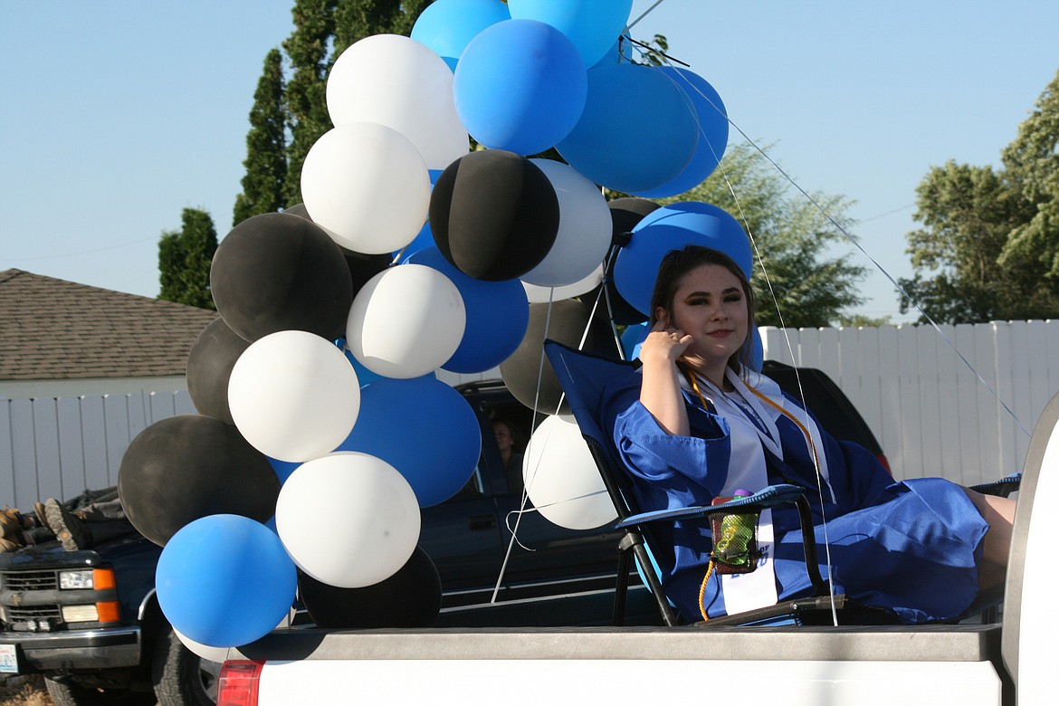Cheryl Schweizer/Columbia Basin Herald      A Warden High School senior enters the campus in style during graduation ceremonies Friday night.