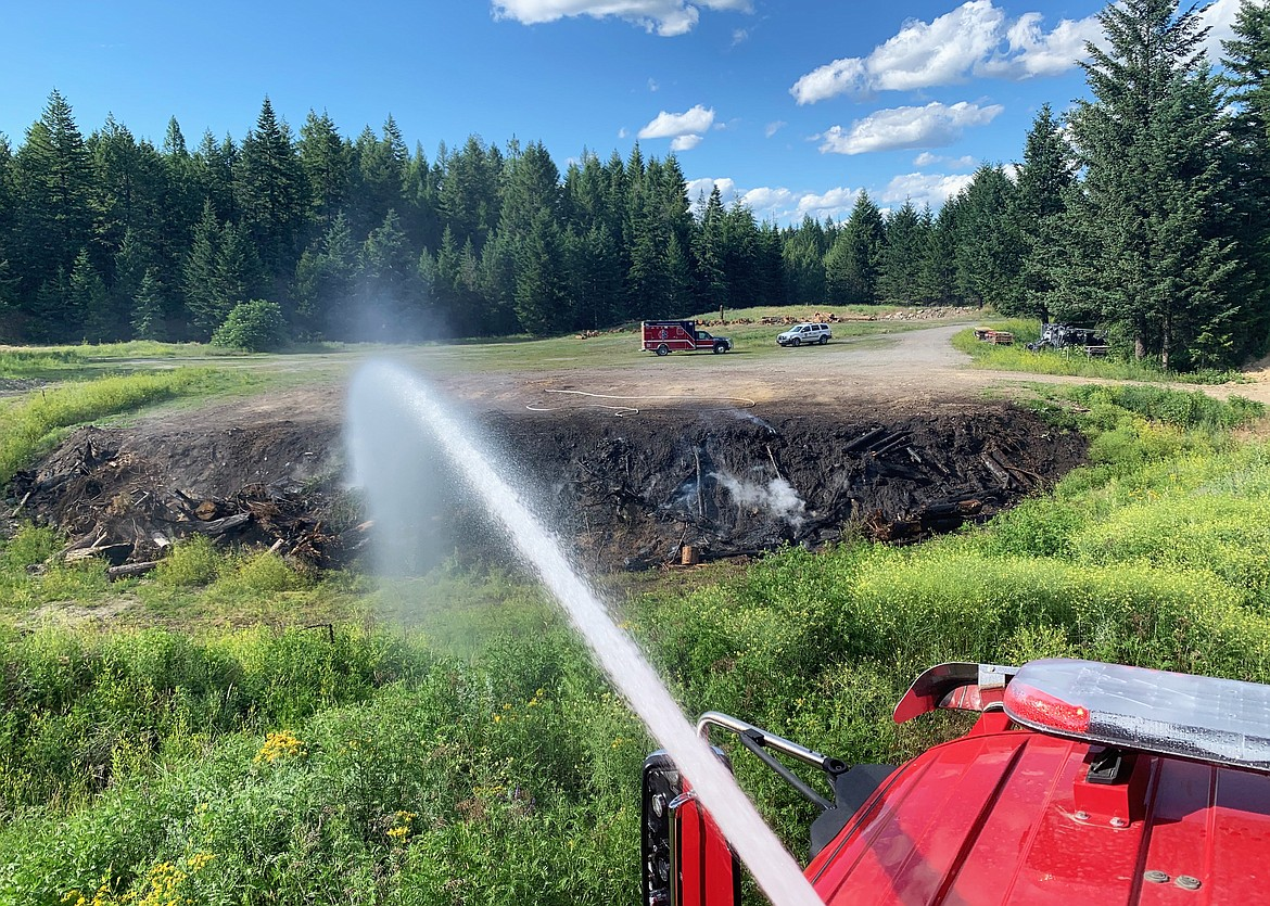 A Timberlake Fire apparatus sprays down Farragut State Park on July 13, 2020. With the heat advisory and dry weather this week, fire officials have offered tips for staying safe, including bringing a fire extinguisher when camping and making sure chains don't drag on roadways. (Photo courtesy of Timberlake Fire)