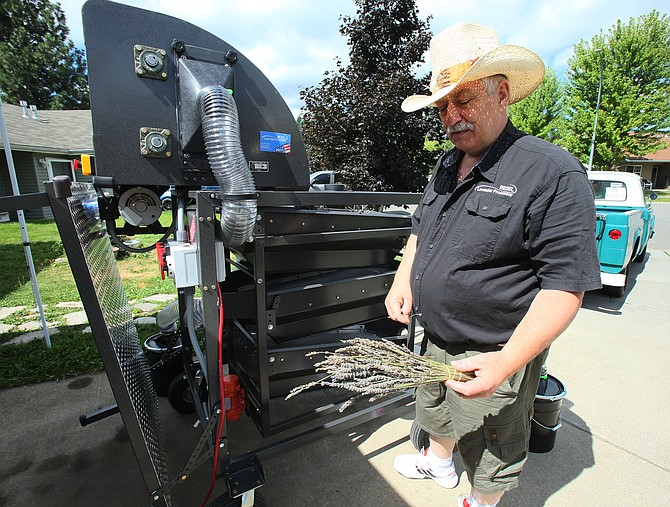 Ricardo Besel prepares to conduct a demonstration of the Besel Lavender Processor in his Coeur d'Alene driveway.