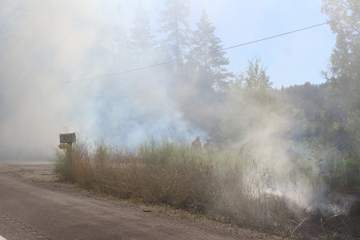 (Photo by VICTOR CORRAL MARTINEZ)   Firemen begin to extinguish multiple firesreported in the 499000 block of U.S. 95 on Monday afternoon.