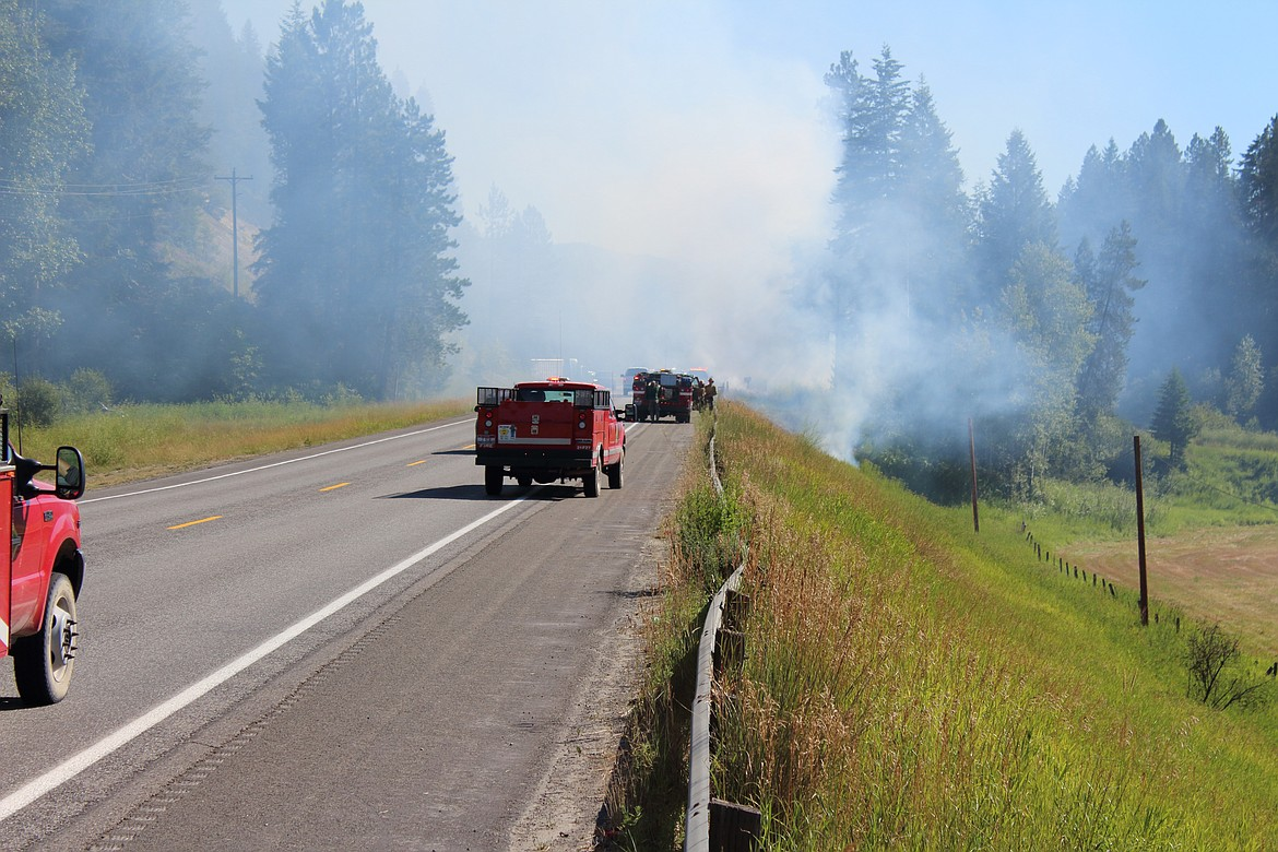 Multiple emergency service agencies arrive on the scene of a fire reported in the area of Highway 95 south of milepost 499 around 3:45 p.m. Monday. Arson is suspected in several wildfires reported this week.