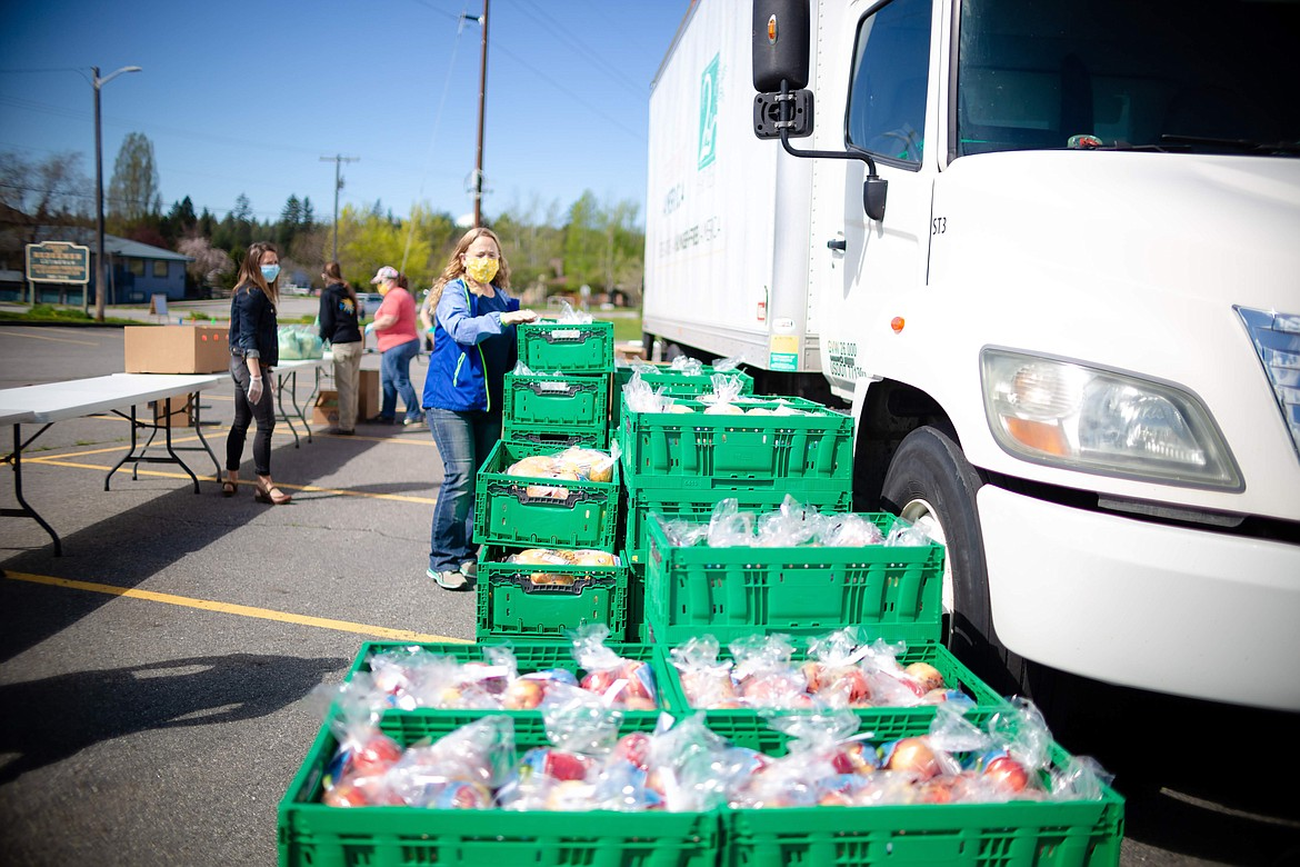 (Photo courtesy CHRIST OUR REDEEMER LUTHERAN CHURCH)   Volunteers from Christ Our Redeemer Lutheran Church help out at a recent food distribution event. Christ Our Redeemer Lutheran Church in Sandpoint is partnering with 2nd Harvest of Spokane to bring a fourth emergency food distribution to our area on Friday, Aug. 14.