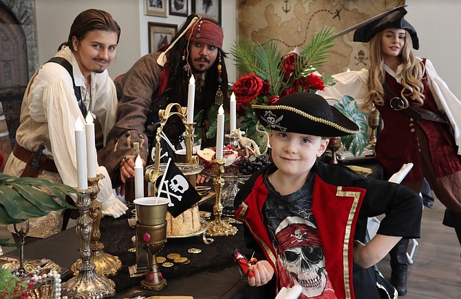 "Actors portraying the ""Pirates Of The Caribbean's"" Will Turner, Jack Sparrow and Elizabeth Swann swashbuckle alongside partygoer Aiden Branson for Dreams Are Forever's grand opening in May. The event company that specializes in themed party appearances has had to make several adjustments since COVID-19 struck."