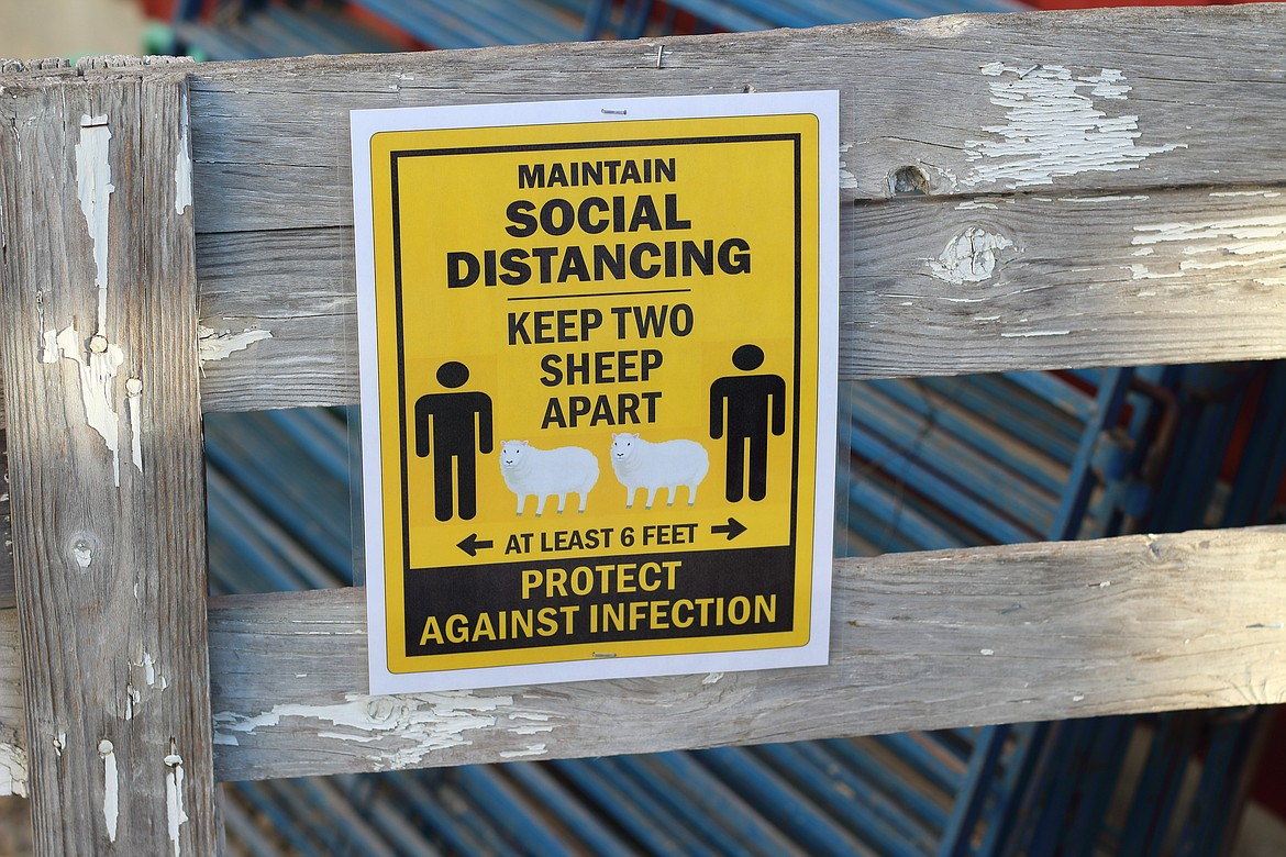 (Photo by VICTOR CORRAL MARTINEZ) The Boundary County Fair got creative with its signs for social distancing.