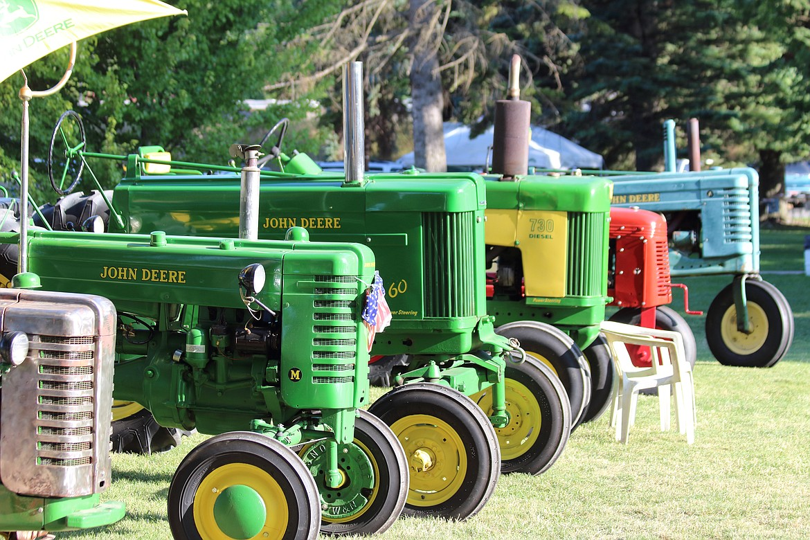 (Photo by VICTOR CORRAL MARTINEZ)   Antique tractors line the grounds at the Boundary County Fair last week.