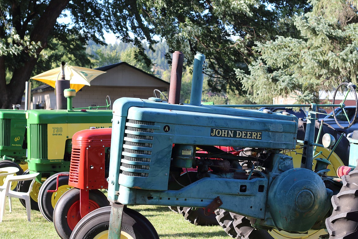(Photo by VICTOR CORRAL MARTINEZ)   Antique tractors line the lawns at the Boundary County Fair last week.