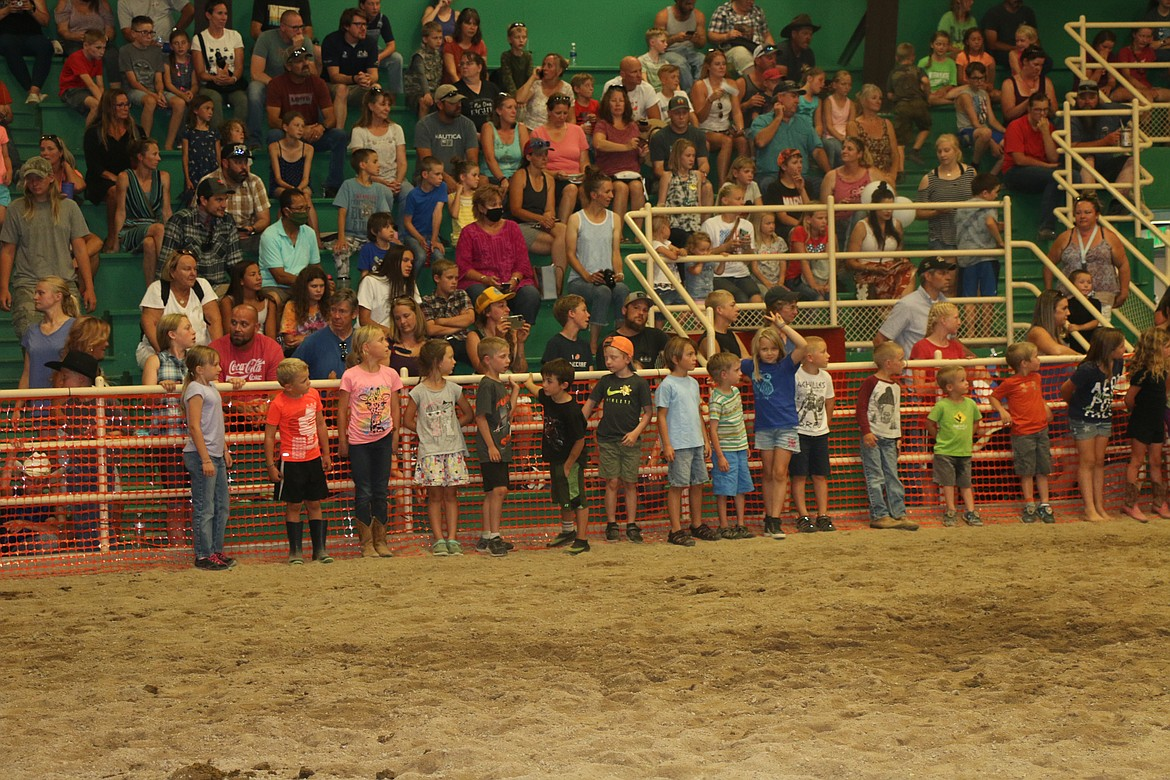 Youngsters wait their turn to attempt to catch a greased pig at last week's Bonner County Fair.