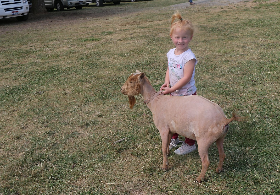 Keely Vanhorn poses with her sheep while taking it for a walk at the Bonner County Fair last week.