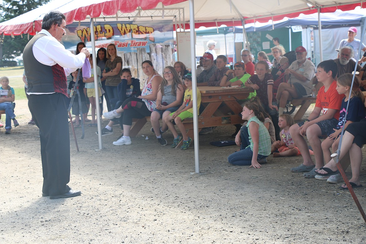 Cecil the Magician performs to a delighted crowd at the Bonner County Fair last week.