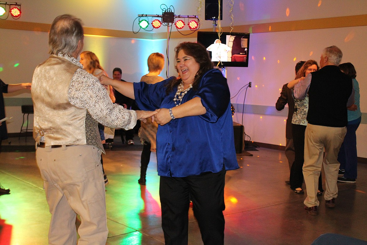 Cheryl Schweizer/Columbia Basin Herald Audience members were urged to get up and dance along with the Masquers Theater cast during their performance of 'Under the Sea' at the Columbia Basin Allied Arts soiree last year.