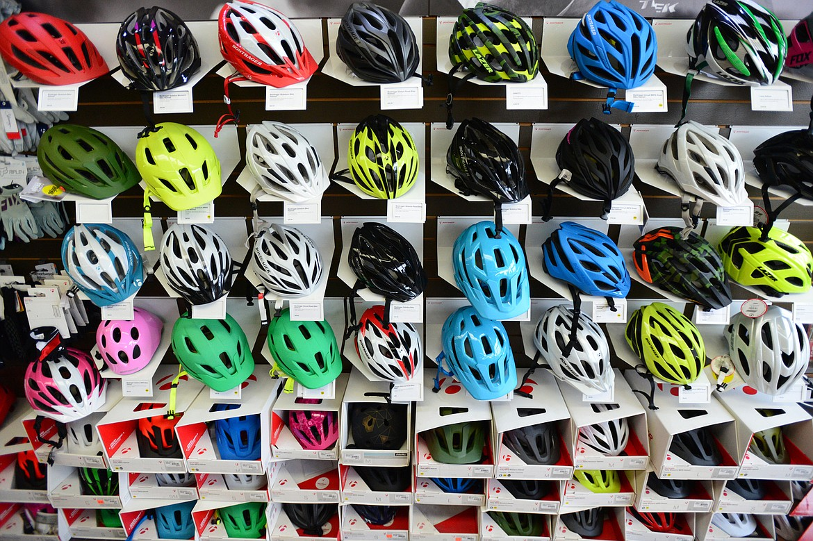 Bike helmets on display at Wheaton's Cycle in Kalispell on Thursday, March 8. (Casey Kreider/Daily Inter Lake)